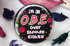 O.B.E - 80th Party Badge